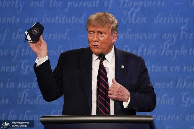 انتقاد از ترامپ به دلیل برداشتن ماسک هنگام بازگشت به کاخ سفید